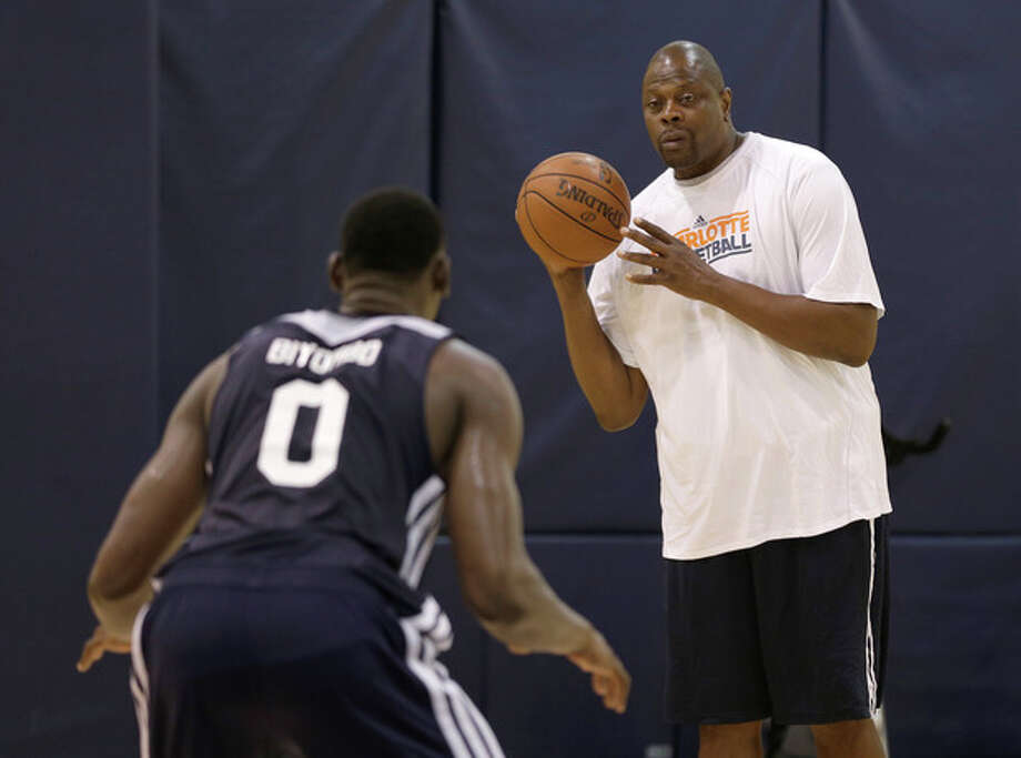 Charlotte Bobcats assistant coach Patrick Ewing, right, works out Bismack Biyombo, left, during the NBA team's summer league basketball practice in Charlotte, N.C., Monday, July 8, 2013. Biyombo, the No. 7 overall pick in the 2011 NBA draft, will have to compete for playing time now that the Bobcats are stocking up on big men. (AP Photo/Chuck Burton) / AP