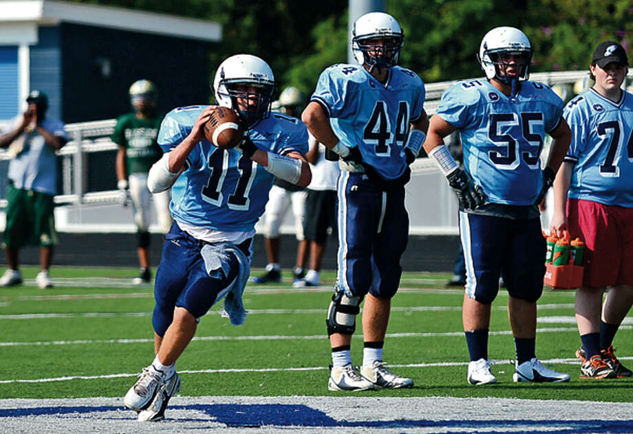 Wilton High School QB looks to pass during the Wilton High School preseason football jamboree Saturday. Hour photo / Erik Trautmann / (C)2012, The Hour Newspapers, all rights reserved