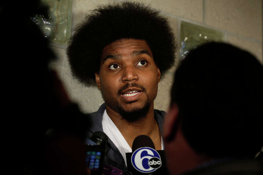 FILE - In this March 1, 2013 file photo, Philadelphia 76ers' Andrew Bynum speaks to members of the media at the team's NBA training facility in Philadelphia. A person familiar with the visit says the Cleveland Cavaliers are hosting free agent center Andrew Bynum. The 7-foot Bynum, who didn't play one game for Philadelphia last season because of a knee injury, is meeting with team officials Monday, July 8, 2013, said the person who spoke on condition of anonymity because of the sensitivity of negotiations. (AP Photo/Matt Rourke, File) / AP