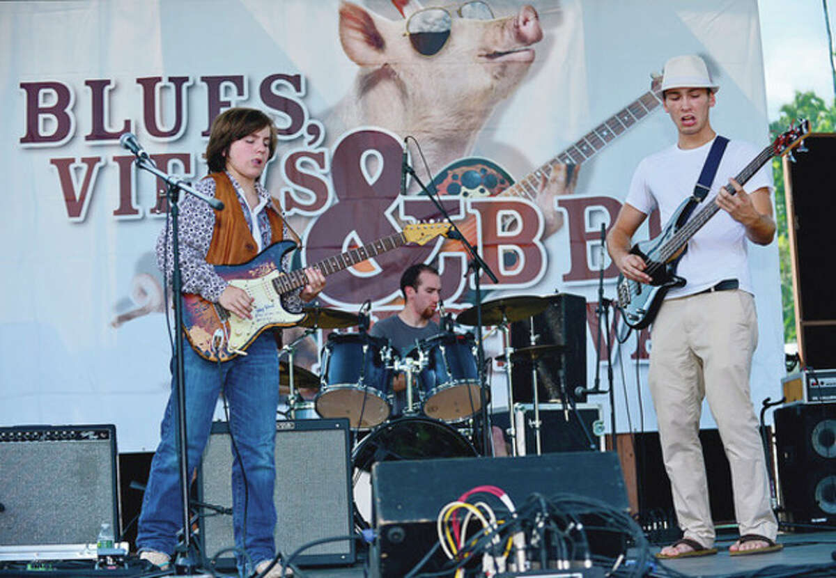 Bobby Palfaut Jr. and his band play the blues at the Blues, Views and BBQ Festival in Westport Saturday. Hour photo / Erik Trautmann