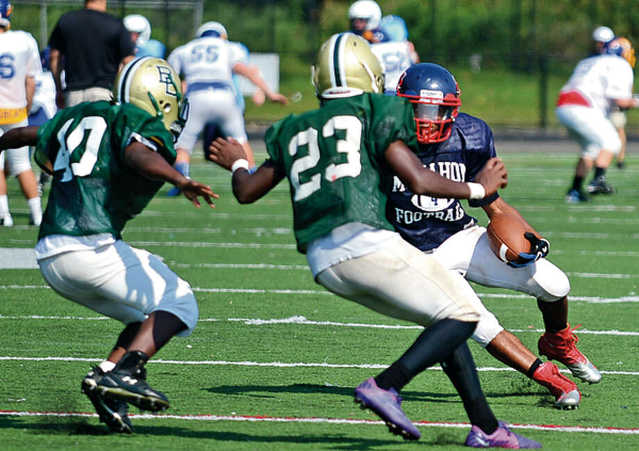 Malik Whittaker runs the ball for the BMHS Senators at the annual Wilton High School preseason football jamboree Saturday where ten teams scrimmaged against each other. Hour photo / Erik Trautmann / (C)2012, The Hour Newspapers, all rights reserved