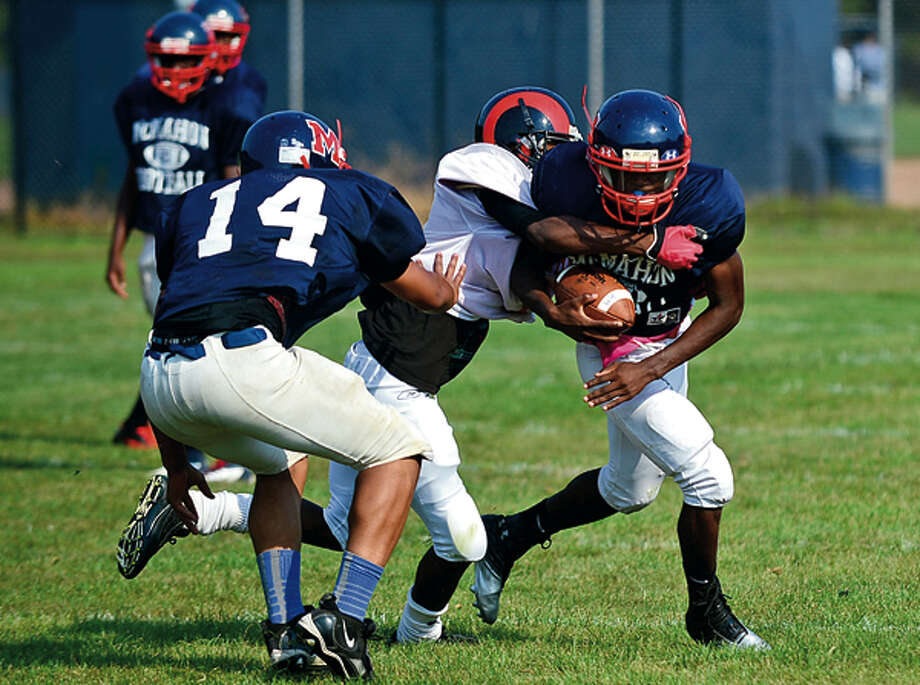 Travon Forney runs the ball ofr the BMHS Senators at the annual Wilton High School preseason football jamboree Saturday where ten teams scrimmaged against each other. Hour photo / Erik Trautmann / (C)2012, The Hour Newspapers, all rights reserved