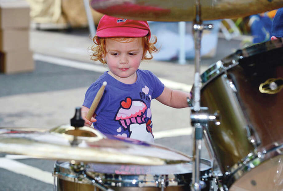 Elizabeth Wagner tries her hands at thew drums during the Blues, Views and BBQ Festival in Westport Saturday.Hour photo / Erik Trautmann / (C)2012, The Hour Newspapers, all rights reserved