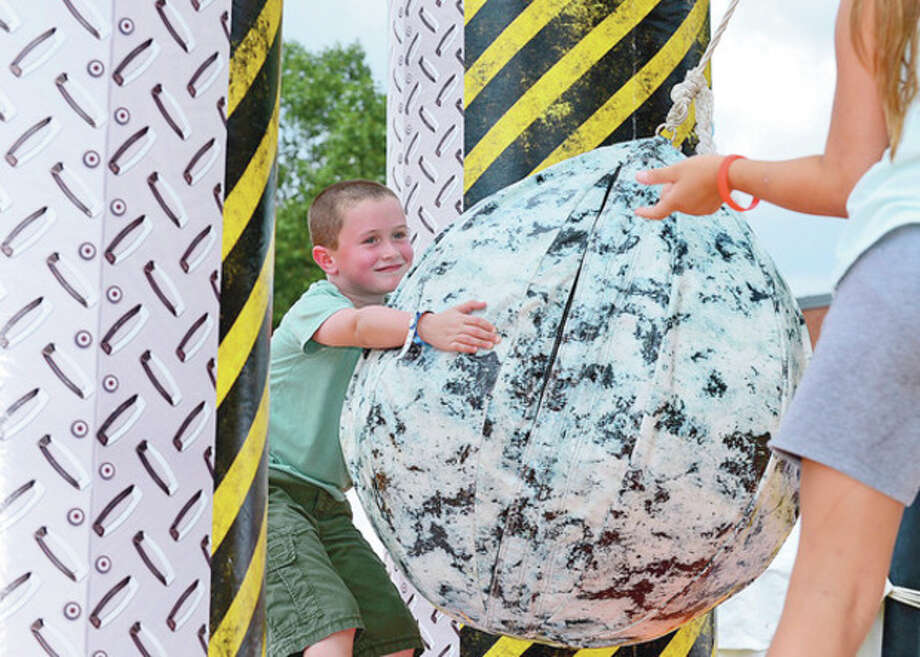 Connor Zavory, 6, plays with the wrecking ball at the Blues, Views and BBQ Festival in Westport Saturday.Hour photo / Erik Trautmann / (C)2012, The Hour Newspapers, all rights reserved