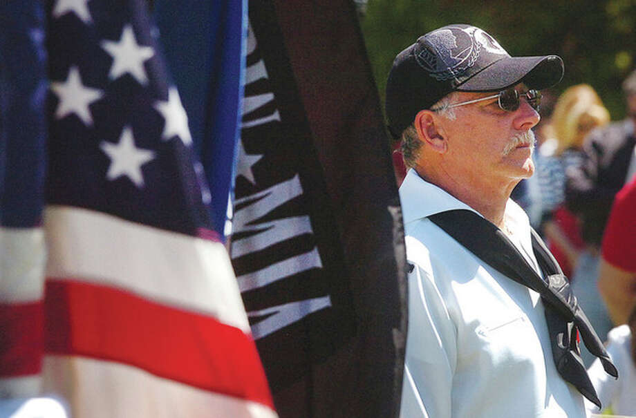 Hour Photo/Alex von Kleydorff American Legion Post 86 Commander Don Hazzard stands at attention during a solemn moment at Hillside Cemetery / 2013 The Hour Newspapers