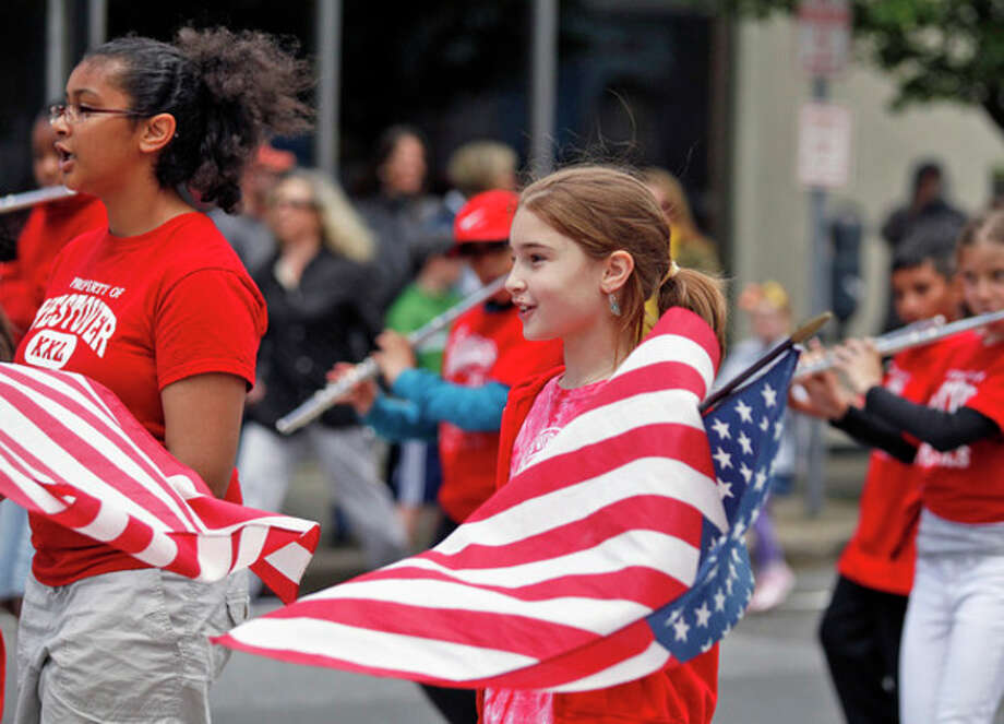 Alexandra Gliga from Westover Magnet School marches in Stamford's Memorial Day Parade Sunday afternoon.Hour Photo / Danielle Robinson