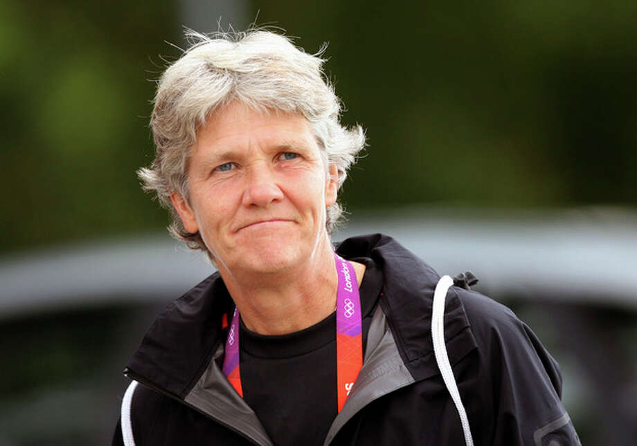 "FILE - This Aug. 2, 2012 file photo shows U.S. women's soccer head coach Pia Sundhage arriving at a soccer practice for the 2012 London Summer Olympics at Cochrane Park in Newcastle, England. After leading the team to two Olympic gold medals and its first spot in a World Cup final in more than a decade, Sundhage is stepping down. Saturday's announcement of Sundhage's departure came just a few hours before the Americans kicked off their ""victory tour"" to celebrate their gold medal at the London Olympics, where the Americans beat Japan 2-1 in a rematch of last year's World Cup final. The search for a new coach will begin immediately. (AP Photo/Scott Heppell, File) / AP"