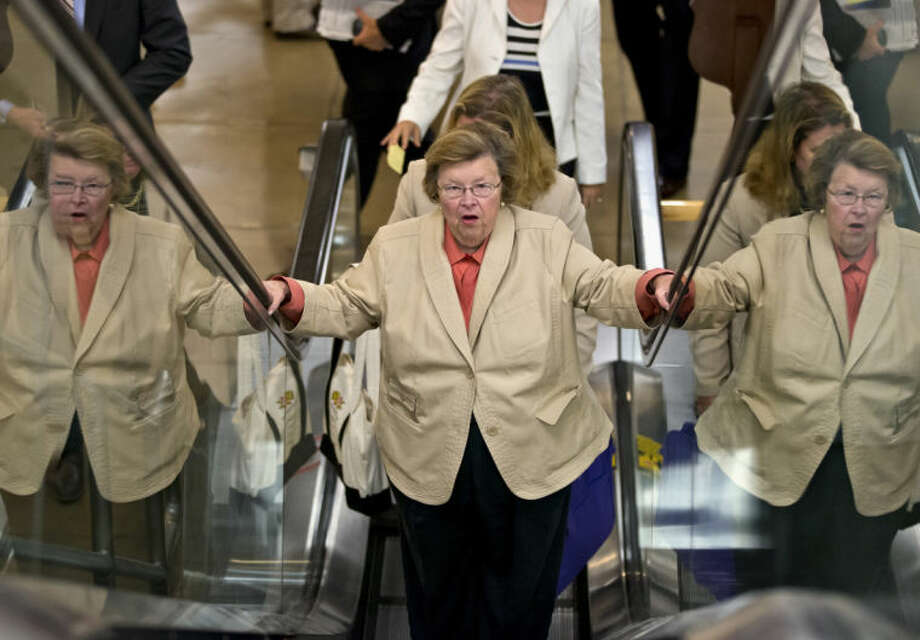Senate Appropriations Committee Chair Sen. Barbara Mikulski, D-Md. rides an escalator on Capitol in Washington, Wednesday, July 10, 2013, as senators rushed to the floor for a vote to end debate on the Democrats' plan to restore lower interest rates on student loans one week after Congress' inaction caused those rates to double. The White House and most Senate Democrats favored restoring interest rates on subsidized Stafford loans to 3.4 percent for another year, but lawmakers failed to muster the necessary 60 votes to overcome a procedural hurdle. (AP Photo/J. Scott Applewhite)