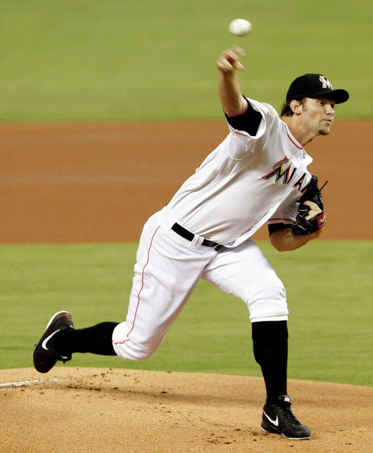 Miami Marlins' Josh Johnson pitches against the New York Mets in the first inning of a baseball game in Miami, Saturday, Sept. 1, 2012. (AP Photo/Alan Diaz) / AP