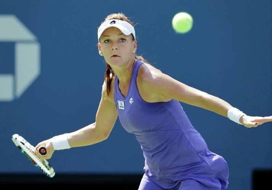 Agnieszka Radwanska, of Poland, returns a shot to Serbia's Jelena Jankovicin the third round of play at the 2012 US Open tennis tournament, Saturday, Sept. 1, 2012, in New York. (AP Photo/Kathy Willens) / AP