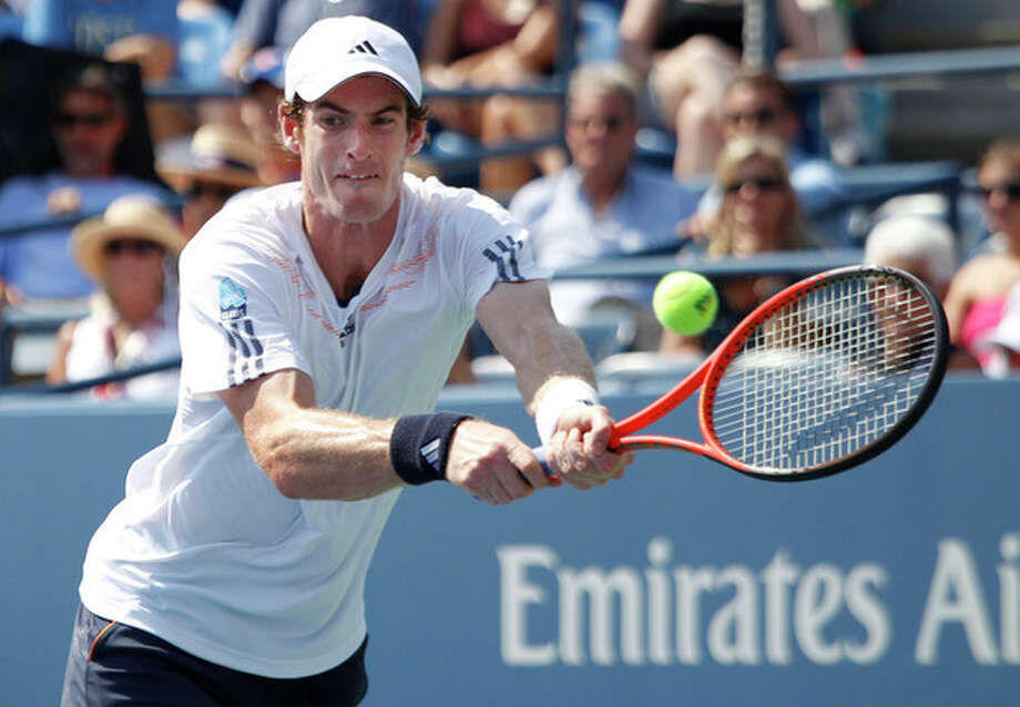 Britain's Andy Murray returns a shot to Spain's Feliciano Lopez in the third round of play at the 2012 US Open tennis tournament, Saturday, Sept. 1, 2012, in New York. (AP Photo/Mel C. Evans) / AP