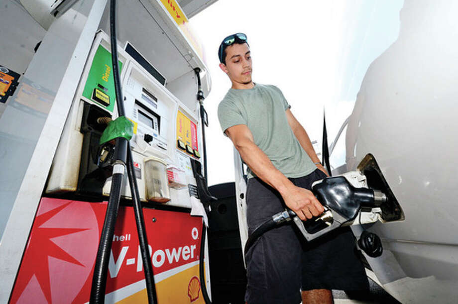 Baltazar Suarez fills up his work van for FRAMA Exclusives at a Shell Station on Main Ave. Friday. House Bill 6534 repeals a current requirement that Connecticut gas stations install and regularly maintain stage II vapor recovery systems on their gas pumps. Since 2000, on-board vapor recovery (ORVR) equipment has been incorporated directly into the design of all new passenger vehicles, which serves much the same purpose as state II vapor systems. The requirement was introduced in the early 1990's to prevent the emission of harmful ozone and other pollutants as customers refueled their cars.Hour photo / Erik Trautmann / (C)2013, The Hour Newspapers, all rights reserved