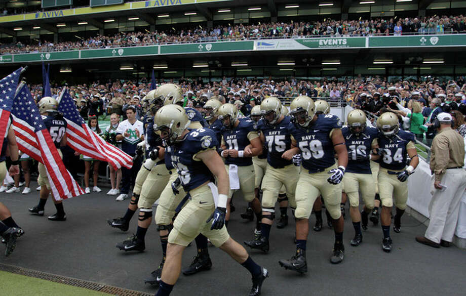 Navy football players make their way onto the pitch before their NCAA college football game against Notre Dame in Dublin, Ireland, Saturday, Sept. 1, 2012. (AP Photo/Peter Morrison) / AP