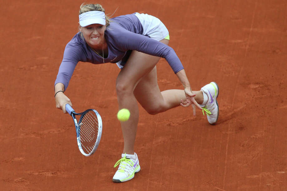 Russia's Maria Sharapova returns against Canada's Eugenie Bouchard in their second round match at the French Open tennis tournament, at Roland Garros stadium in Paris, Friday, May 31, 2013. Sharapova won in two sets 6-2, 6-4, the match was suspended Thursday because of the rain. (AP Photo/Michel Euler) / AP