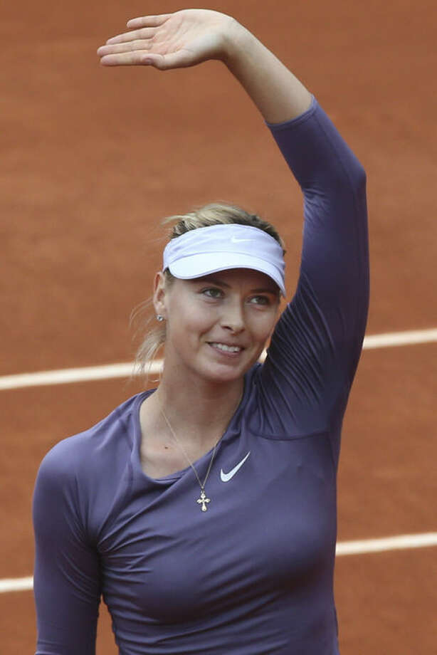 Russia's Maria Sharapova greets spectators after winning her second round match against Canada's Eugenie Bouchard at the French Open tennis tournament, at Roland Garros stadium in Paris, Friday, May 31, 2013. Sharapova won in two sets 6-2, 6-4, the match was suspended Thursday because of the rain. (AP Photo/Michel Euler)