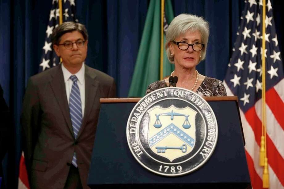 Treasury Secretary Jacob Lew listens at left as Health and Human Services Secretary Kathleen Sebelius speaks about Social Security and Medicare, Friday, May 31, 2013, at the Treasury Department in Washington. The government says Medicare's giant hospital trust will not be exhausted until 2026, while the date that Social Security will exhaust its trust fund is unchanged at 2033. The date for Medicare is two years later than was projected last year. (AP Photo/Charles Dharapak) / AP
