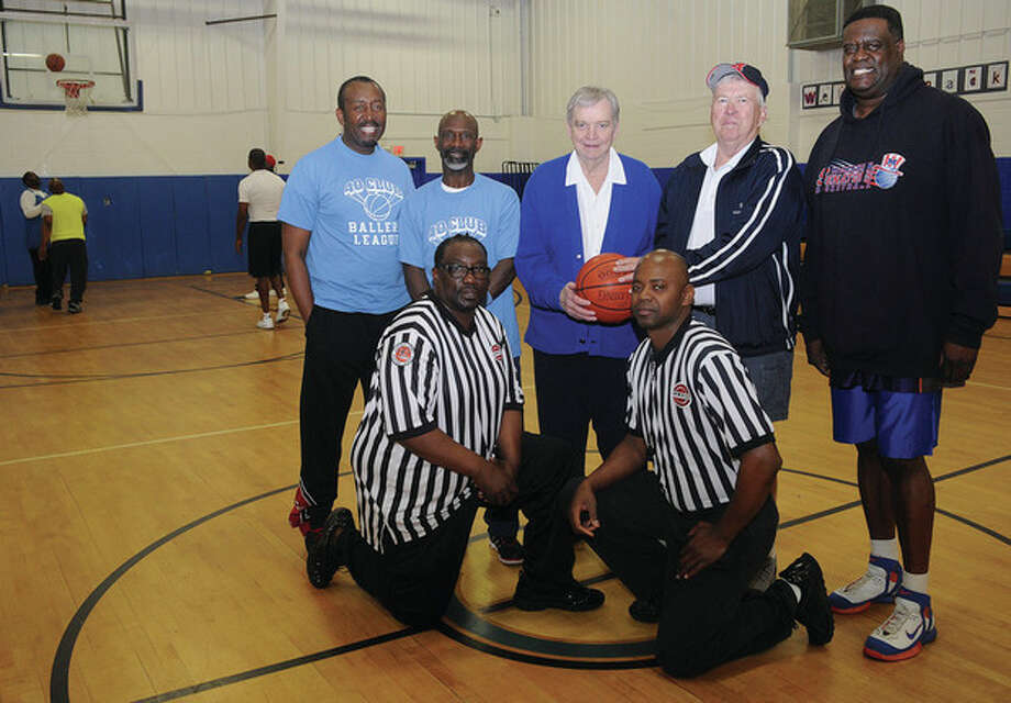 Hour photo/Matthew VinciSeveral former Brien McMahon basketball players are helping to make the inaugural season of the 40 Club Ballers League at the Carver Center a success, and recently invited two former coaches to stop in and see them. Taking timeout for a photo before the opening tip of a recent game were, standing from left, Greg Pritchett, Willie Brooks, Doug Bussing, Ralph King, and Paul Atkins. Kneeling are Mark McElveen and Gene Weldon.