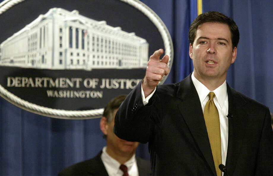 FILE - In this Jan. 14, 2004 file photo, Deputy Attorney General James Comey gestures during a news conference in Washington. President Barack Obama is preparing to nominate former Bush administration official James Comey to head the FBI, people familiar with the decision said Wednesday, May 29, 2013. (AP Photo/Evan Vucci, File) / AP