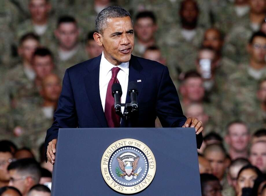 President Barack Obama speaks to troops, service-members and military families at the 1st Aviation Support Battalion Hangar at Fort Bliss ,Friday, Aug. 31, 2012, in El Paso, Texas. (AP Photo/Tony Gutierrez) / AP
