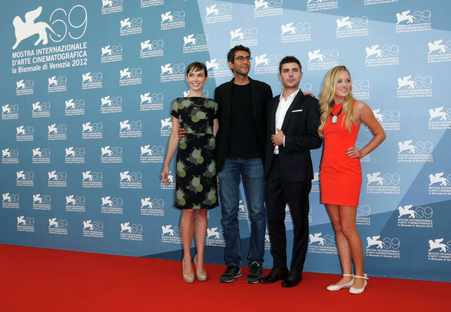 Screenwriter Hallie Elizabeth Newton, director Ramin Bahrani, actors Zac Efron and Maika Monroe pose at the photo call for the film 'At Any Price' during the 69th edition of the Venice Film Festival in Venice, Italy, Friday, Aug. 31, 2012. (AP Photo/Joel Ryan) / AP