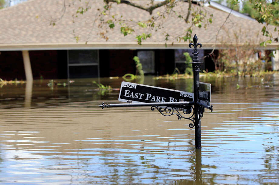 A flooded home from Hurricane Isaac is seen in Braithwaite, La., Saturday, Sept. 1, 2012. While New Orleans streets were bustling again and workers were returning to offshore oil rigs, thousands of evacuees couldn't return home to flooded low-lying areas of Louisiana and more than 400,000 sweltering electricity customers in the state remained without power. (AP Photo/Gerald Herbert) / AP