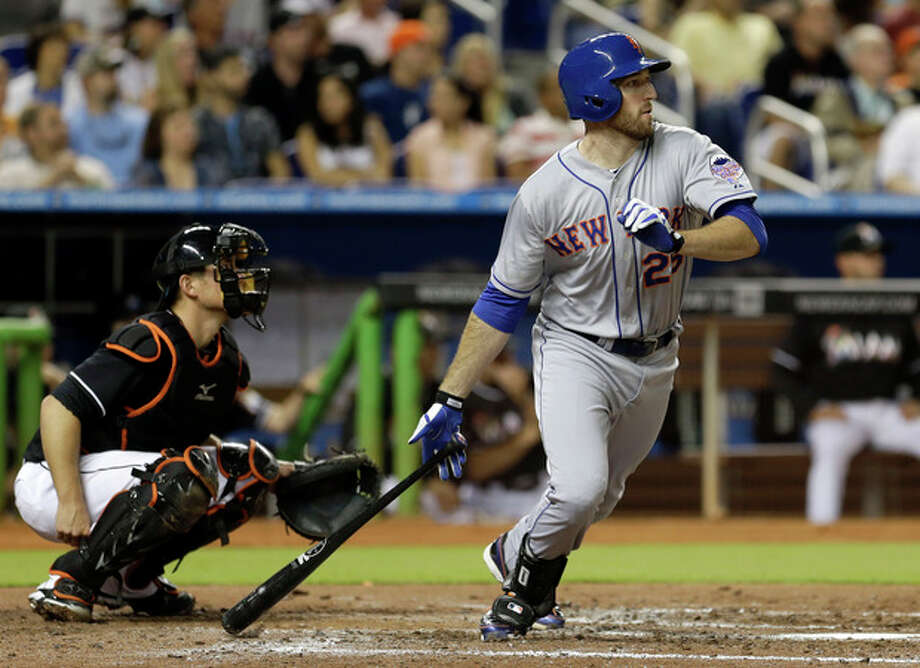 New York Mets' Ike Davis (29) prepares to run the bases after hitting a double as he keeps an eye on the ball while Miami Marlins catcher Jeff Mathis, looks on in the fifth inning of a baseball game, Friday, May 31, 2013, in Miami. (AP Photo/Alan Diaz) / AP
