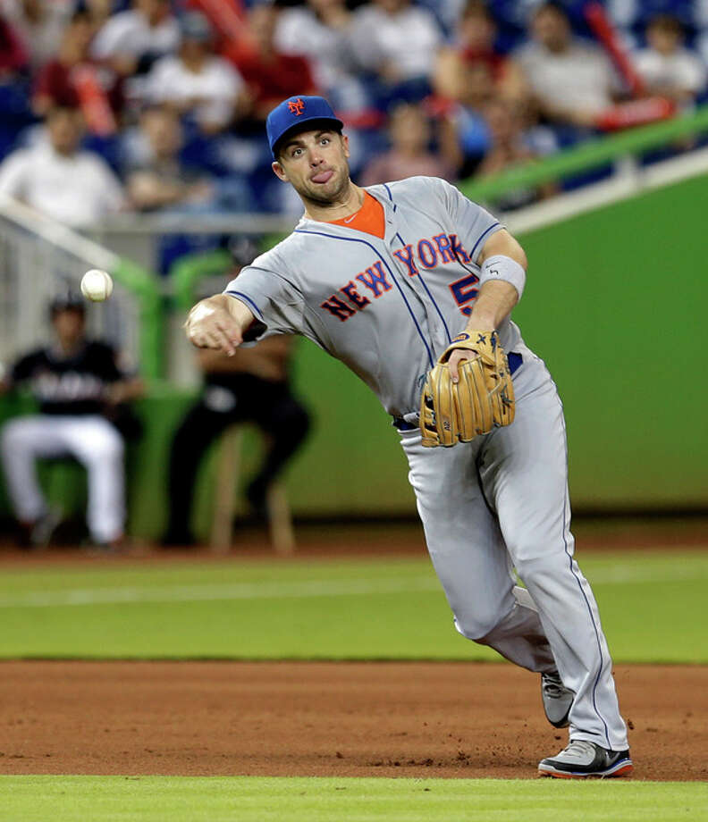 New York Mets third baseman David Wright throws to first base after fielding a ground ball by Miami Marlins second baseman Derek Dietrich (51) in the fourth inning of a baseball game, Friday, May 31, 2013, in Miami. Dietrich was out at first base. (AP Photo/Alan Diaz) / AP