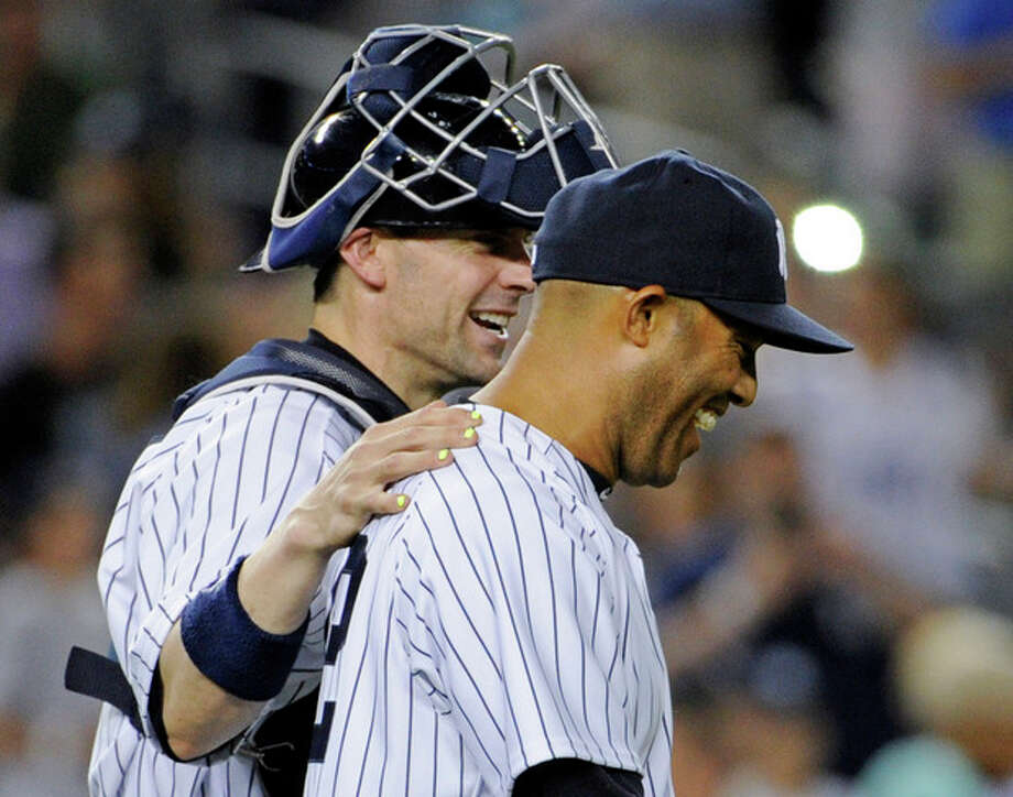 New York Yankees pitcher Mariano Rivera, right, celebrates with catcher Chris Stewart after they defeated the Boston Red Sox 4-1 in a baseball game on Friday, May 31, 2013, at Yankee Stadium in New York. (AP Photo/Bill Kostroun) / FR51951 AP
