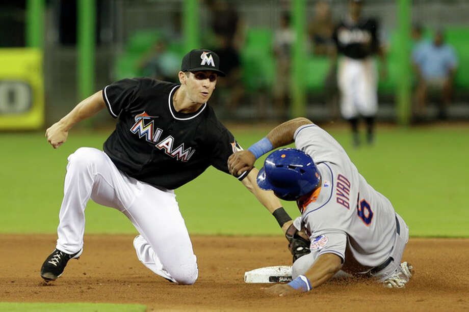 Miami Marlins shortstop Ed Lucas, left, tags out New York Mets' Marlon Byrd (6) stealing second base in the fifth inning of a baseball game, Friday, May 31, 2013, in Miami. (AP Photo/Alan Diaz) / AP