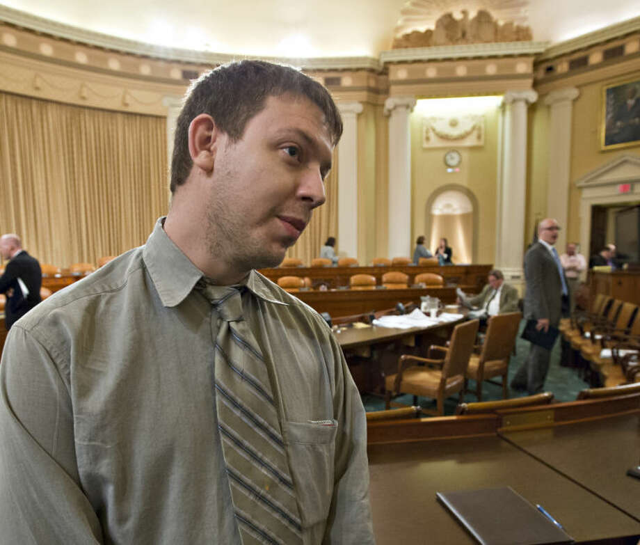 Justin Binik-Thomas, a former Cincinnati Tea Party spokesman and owner of Conservative Media Group, Deer Park, Ohio, talks on Capitol Hill in Washington, Friday, May 17, 2013, during a break in the House Ways and Means Committee hearing on the extra scrutiny the Internal Revenue Service gave Tea Party and other conservative groups that applied for tax-exempt status. During the hearing, Rep. Pat Tiberi, R-Ohio, asked witness, ousted IRS chief Steven Miller why the IRS wanted to know about Binik-Thomas when the Liberty Township Tea Party in Ohio applied for tax-exempt status. (AP Photo/J. Scott Applewhite)