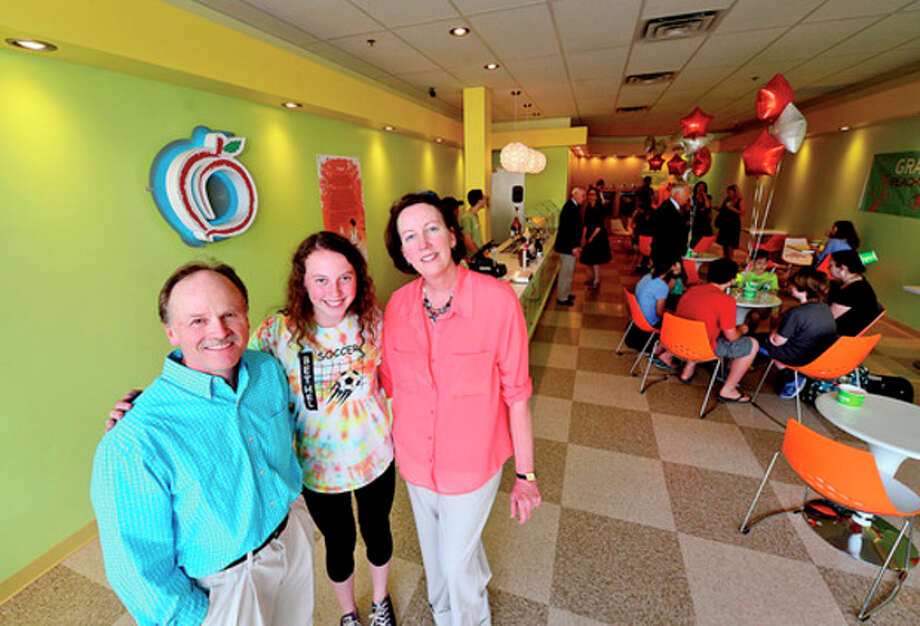 Dave Demment owner, of Peachwave on Main Ave. and his daughter Jessi and wife Laura during their grand opening Friday.Hour photo / Erik Trautmann / (C)2013, The Hour Newspapers, all rights reserved