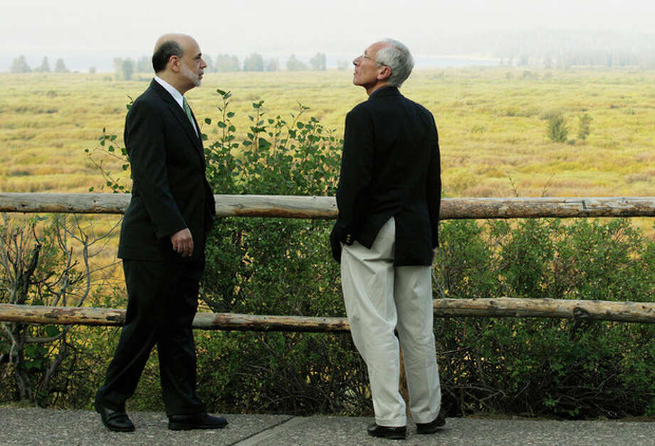 "Federal Reserve Chairman Ben Bernanke, left, and Bank of Israel Governor Stanley Fischer walk together outside of the Jackson Hole Economic Symposium, Friday, Aug. 31, 2012, at Grand Teton National Park near Jackson Hole, Wyo. Bernanke made clear Friday that the Federal Reserve will do more to boost the economy because of high U.S. unemployment and an economic recovery that remains ""far from satisfactory."" (AP Photo/Ted S. Warren) / AP"