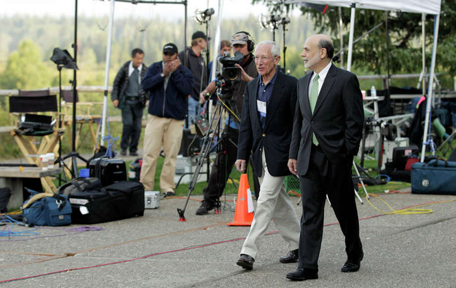 """Federal Reserve Chairman Ben Bernanke, right, and Bank of Israel Governor Stanley Fischer walk together past television cameras outside of the Jackson Hole Economic Symposium, Friday, Aug. 31, 2012, at Grand Teton National Park near Jackson Hole, Wyo. Bernanke made clear Friday that the Federal Reserve will do more to boost the economy because of high U.S. unemployment and an economic recovery that remains """"far from satisfactory."""" (AP Photo/Ted S. Warren) / AP"""