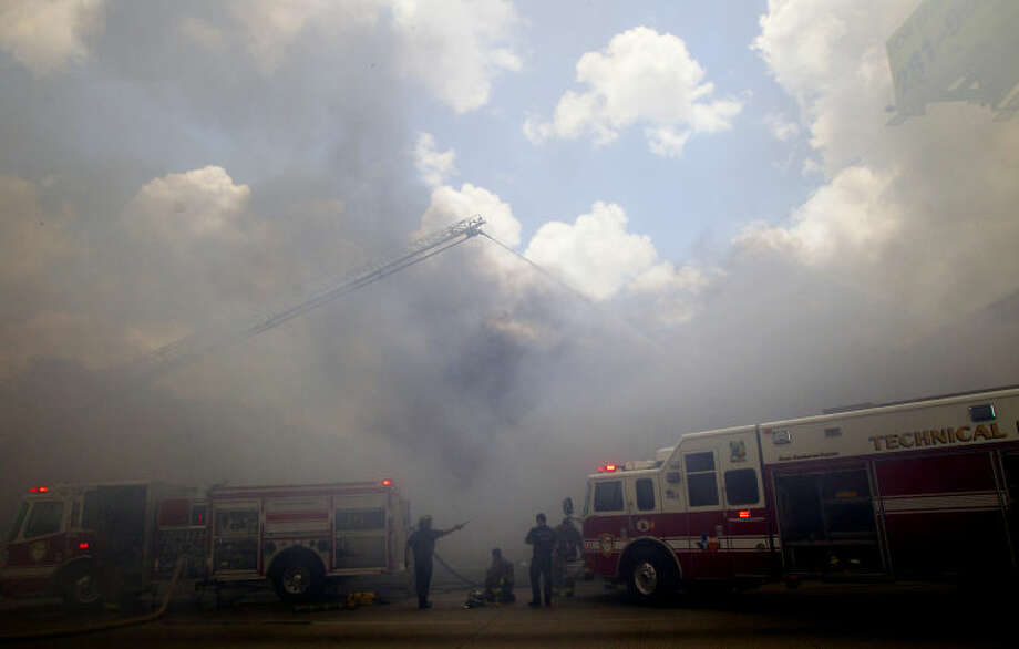 Firefighters try to gain control of a blaze at the Southwest Inn on U.S. 59 in Houston on Friday, May 31, 2013. (AP Photo/Houston Chronicle, Cody Duty)