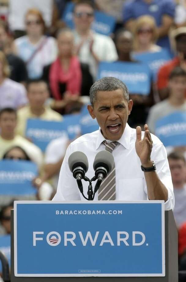 President Barack Obama speaks during a campaign stop at the Living History Farms Saturday, Sept. 1, 2012, in Des Moines, Iowa. (AP Photo/Charlie Riedel)