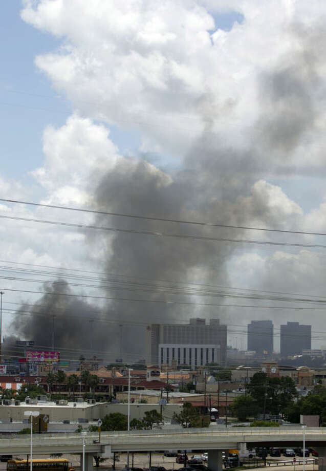 The 5-alarm blaze at a restaurant and then engulfed a hotel as seen from the Westpark Tollway Friday, May 31, 2013, in Houston. Four firefighters searching for people they thought might be trapped in a blazing Houston motel and restaurant Friday were killed when the part of the structure collapsed and ensnared them, authorities said. (AP Photo/Houston Chronicle, Johnny Hanson) MANDATORY CREDIT
