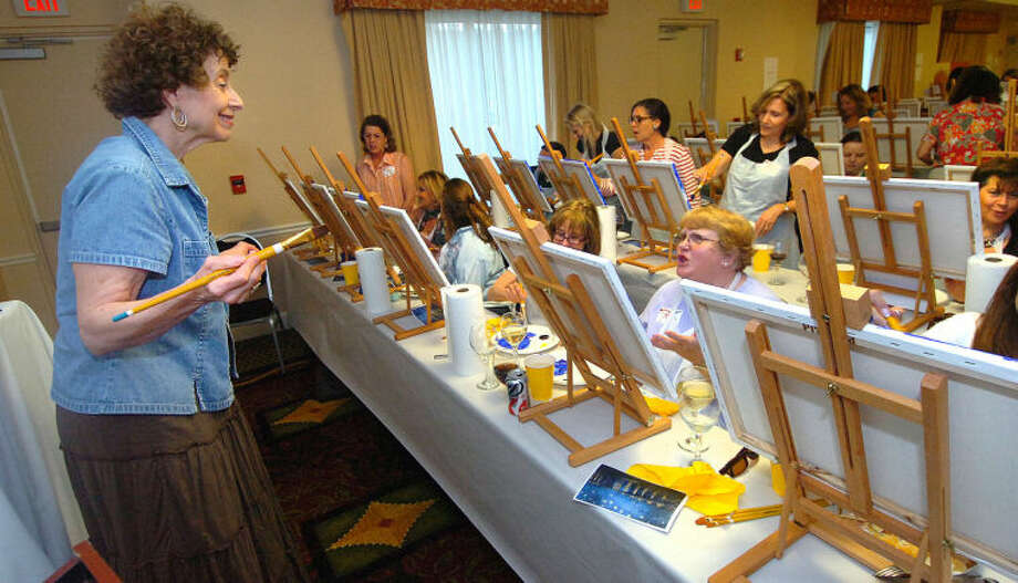 Hour Photo/Alex von Kleydorff. Artist Shelley Loweel gives instruction on how to paint Starry Night by Vincent van Gogh to more that 75 participants at The Hour's Arts and Carafes at Hilton Garden Inn on Friday night