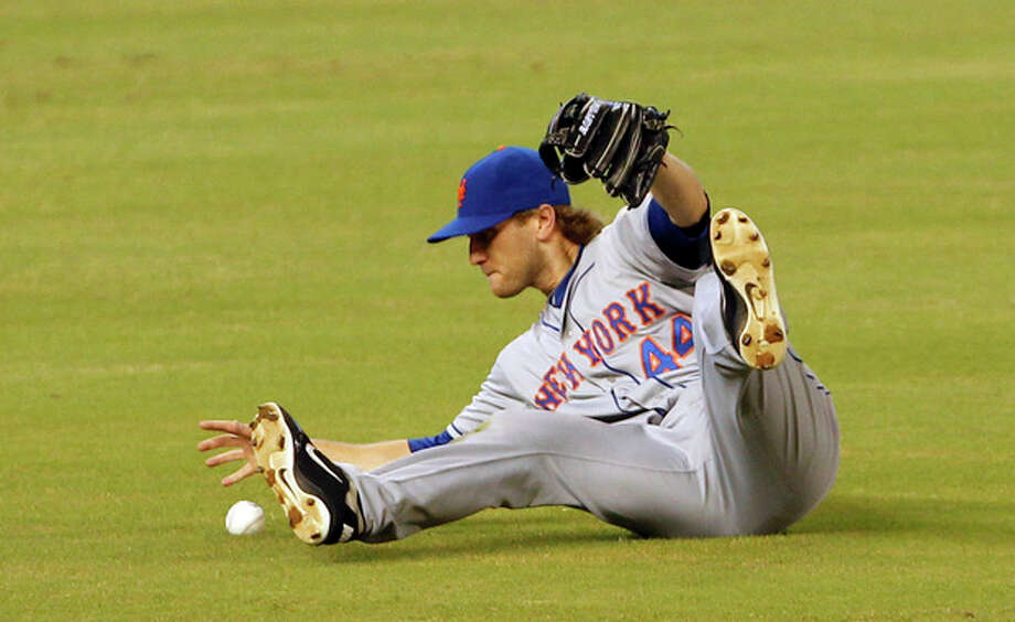 New York Mets left fielder Jason Bay is unable to catch a line drive by Miami Marlins' center fielder Bryan Petersen in the first inning of a baseball game in Miami, Sunday, Sept. 2, 2012. (AP Photo/Alan Diaz / AP