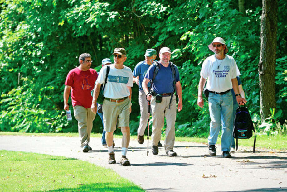 A group of hikers including Dennis D'Amato, Rob McWilliams and David Park start out on a moderate three-mile hike from Mathews Park on the Norwalf River Valley Trail to Deering Pond and as part of a slew of activities scheduled throughout the state in recognition of National Trails Day Weekend.Hour photo / Erik Trautmann / (C)2013, The Hour Newspapers, all rights reserved