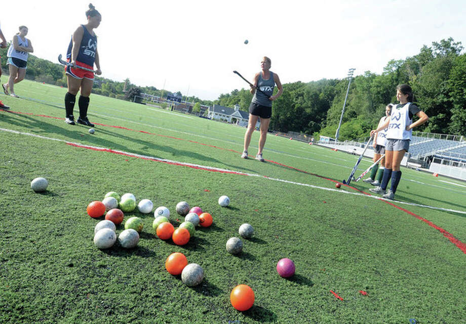 Hour photo/Matthew VinciFormer Olympic team standout Carrie Lingo, center, holds a field hockey clinic Sunday for Wilton High girls at Memorial Stadium.