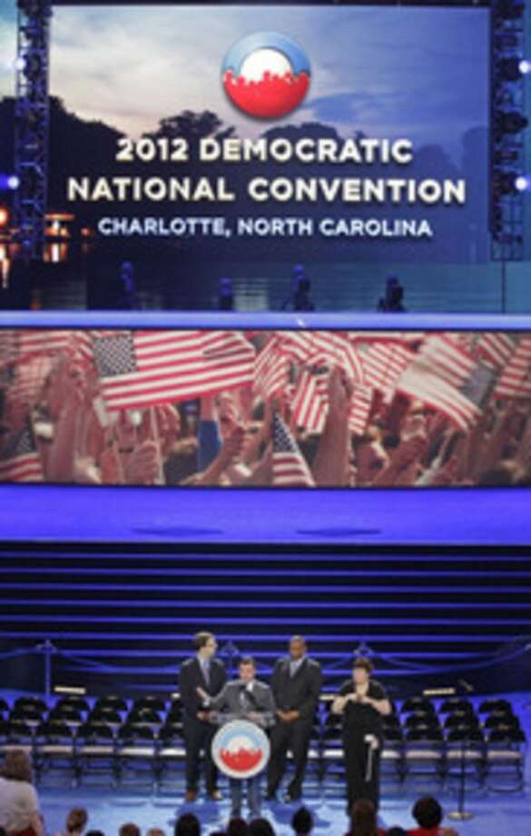Ap photoDNCC CEO Steve Kerrigan, center, speaks during the public unveiling of Democratic National Convention's facilities Time Warner Arena in Charlotte, N.C., Friday.