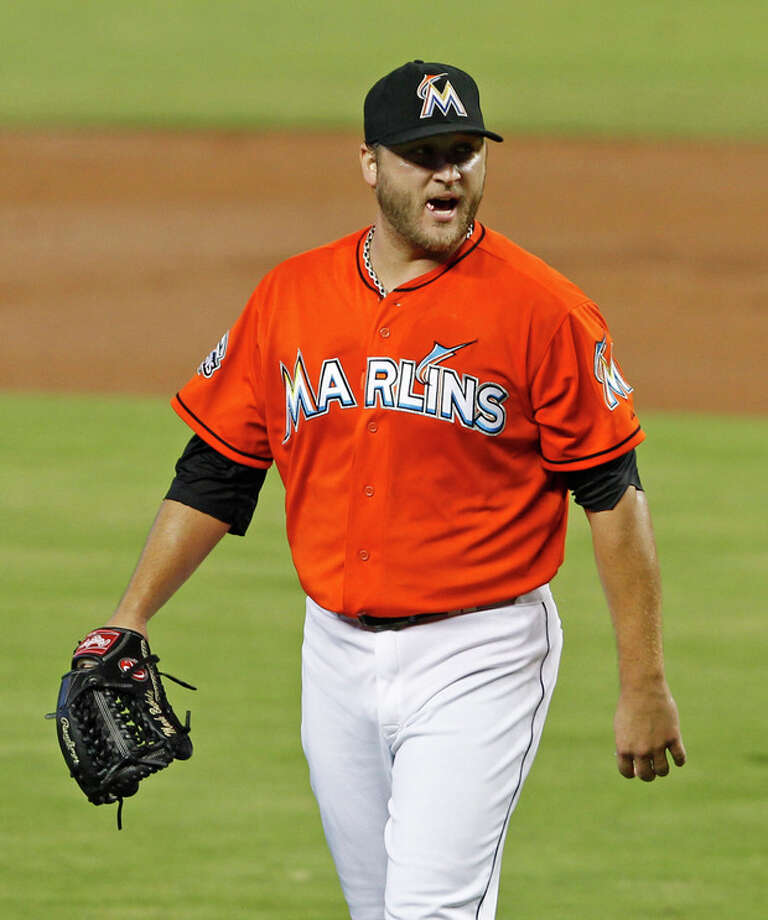 Miami Marlins' Mark Buehrle shouts as he heads to the dugout after giving up five runs to the New York Mets in the first inning of a baseball game in Miami, Sunday, Sept. 2, 2012. (AP Photo/Alan Diaz) / AP