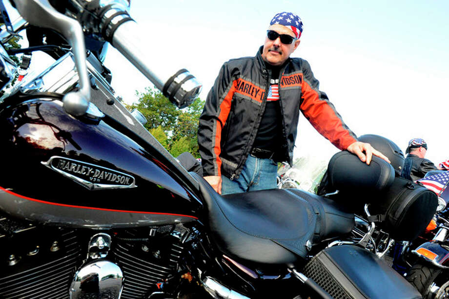Hour file photoMark Bessette with his Harley Davidson Roadking Classic at Nordon Place last year. / (C)2011, The Hour Newspapers, all rights reserved