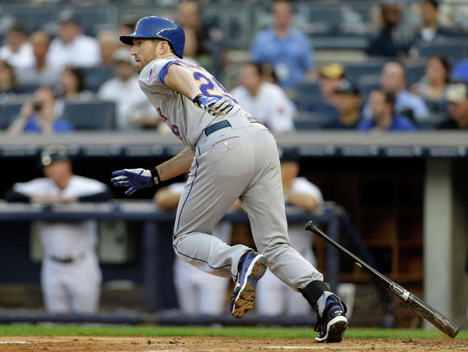 New York Mets' Ike Davis watches his first-inning two-run single off New York Yankees starting pitcher David Phelps (41) in an interleague baseball game at Yankee Stadium in New York, Wednesday, May 29, 2013. (AP Photo/Kathy Willens) / AP