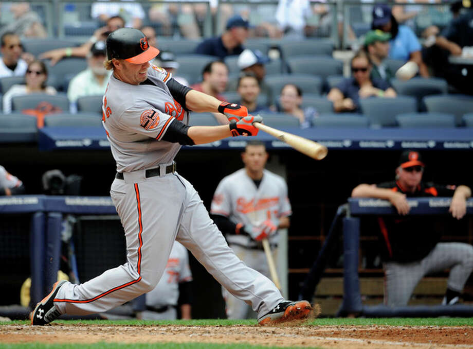 Baltimore Orioles' Mark Reynolds hits a three-run home run off New York Yankees starting pitcher Phil Hughes in the sixth inning of a baseball game on Sunday, Sept. 2, 2012, at Yankee Stadium in New York. (AP Photo/Kathy Kmonicek) / FR170189 AP