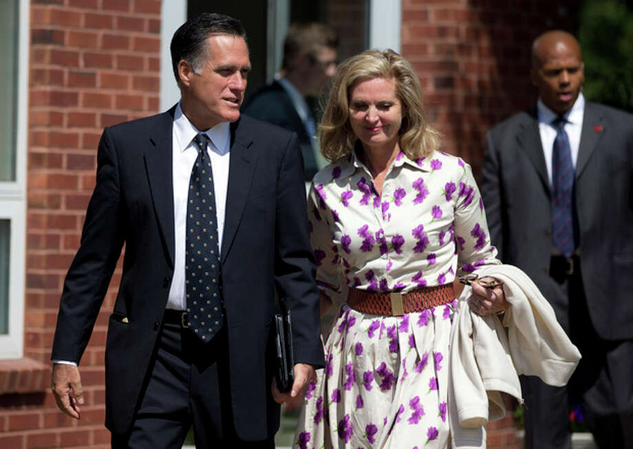 AP Photo/Evan VucciRepublican presidential candidate, former Massachusetts Gov. Mitt Romney and his wife Ann, leave the Church of Jesus Christ of Latter-day Saints after services on Sunday, in Wofeboro, N.H. / AP