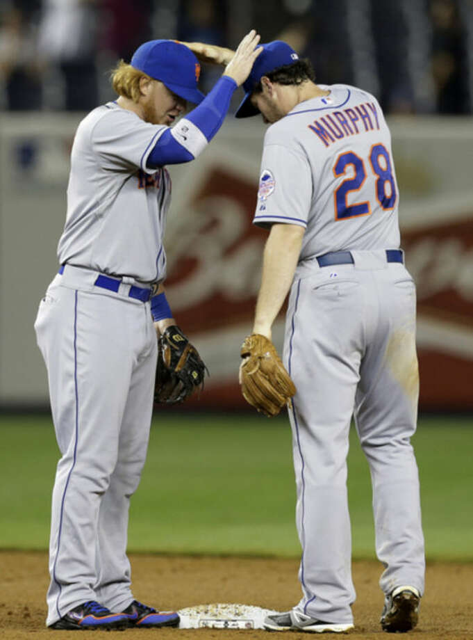 CORRECTS SCORE TO 9-4 NOT 9-3 - New York Mets second baseman Justin Turner (2) congratulates second baseman Daniel Murphy (28) after they defeated the New York Yankees 9-4 in an interleague baseball game at Yankee Stadium in New York, Wednesday, May 29, 2013. (AP Photo/Kathy Willens)