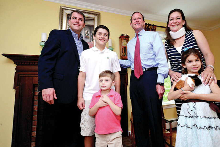 "U.S. Senator Richard Blumenthal visits 5-year-old Patrick ""Patch"" Angerame, who suffered a stroke before he was born, and the Angerame family, including parents Brian and Jennifer Angerame, brother Michael, 11, and sister Katie, 7, at their home to advocate for pediatric stroke awareness. The Angerames sought Blumenthal's help following challenges obtaining insurance coverage for Patrick's medical needs. Senator Blumenthal will introduce a resolution this month recognizing May as Pediatric Stroke Awareness Month. / (C)2013, The Hour Newspapers, all rights reserved"
