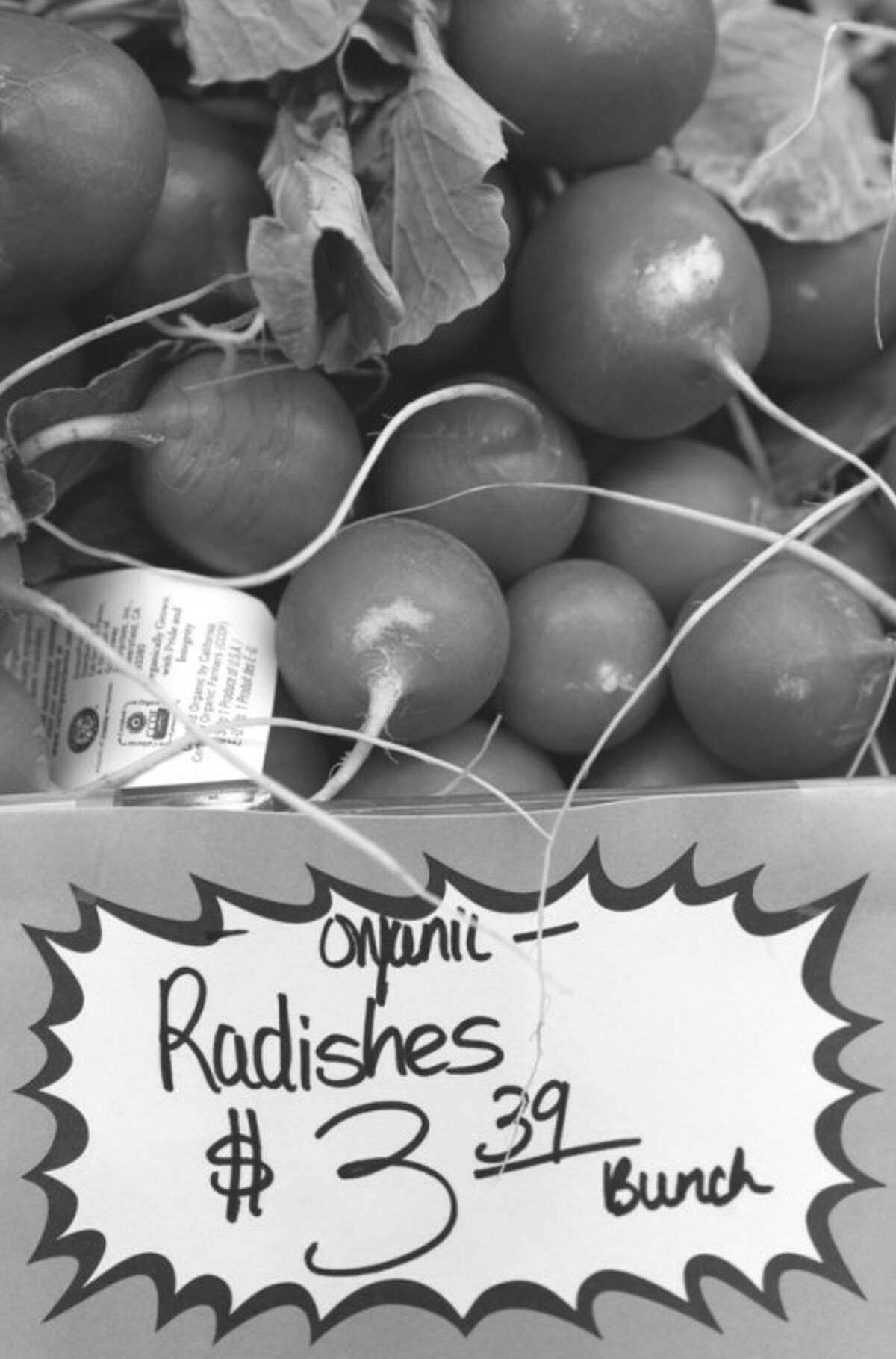 AP file photo This March 2011 file photo shows organic radishes at the Pacifica Farmers Market in Pacifica, Calif.