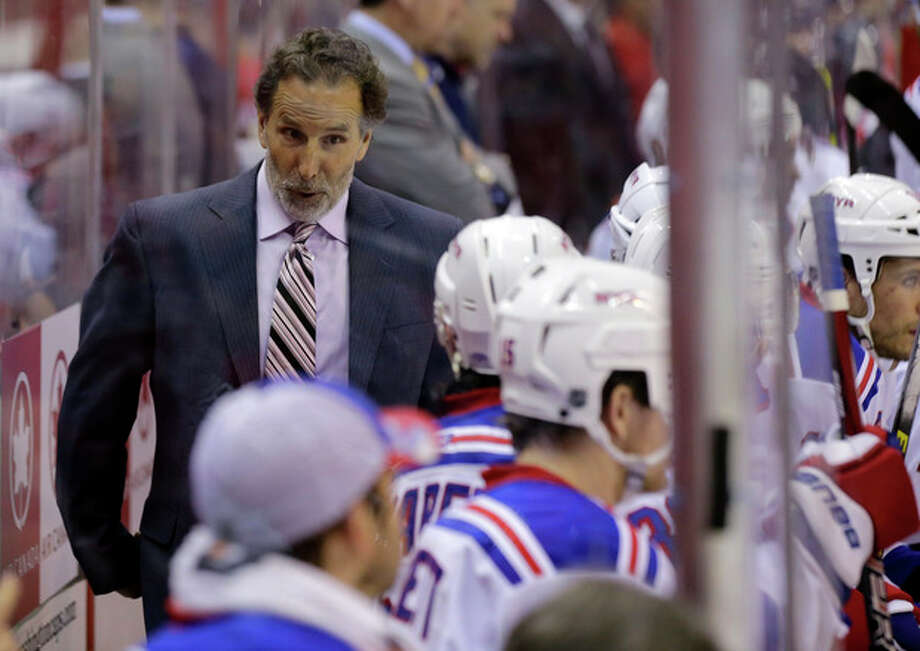 FILE - In this May 10, 2013 file photo, New York Rangers head coach John Tortorella talks with his team in the second period of Game 5 in the first-round NHL Stanley Cup playoff hockey series against the Washington Capitals, in Washington. The Rangers have fired coach Tortorella, Wednesday, May 29, 2013, four days after New York was eliminated from the Stanley Cup playoffs.(AP Photo/Alex Brandon) / AP